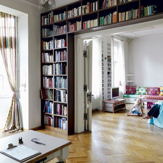 Technicolour-Cologne-apartment-tour-modern-decorating-ideas-living-room-book-storage