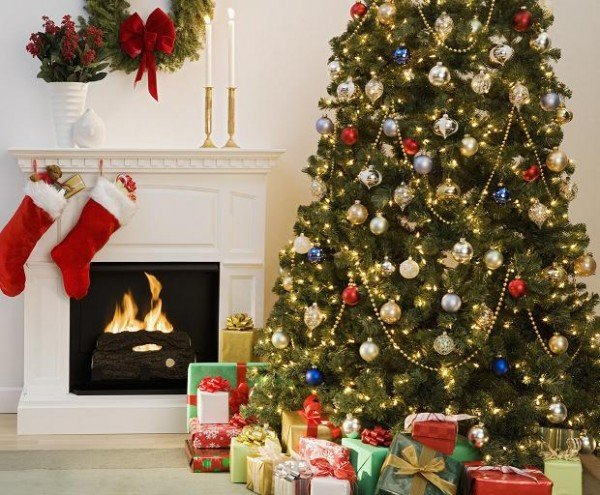 Christmas tree with presents and fireplace with stockings