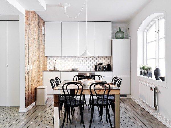 stadshem_wood_wall_gray_floors_white_kitchen_emmas_designblogg_517ee3039606ee31b6afca68