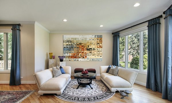 awesome-modern-art-home-lounge-decorating-with-beige-sofas-and-circular-rugs