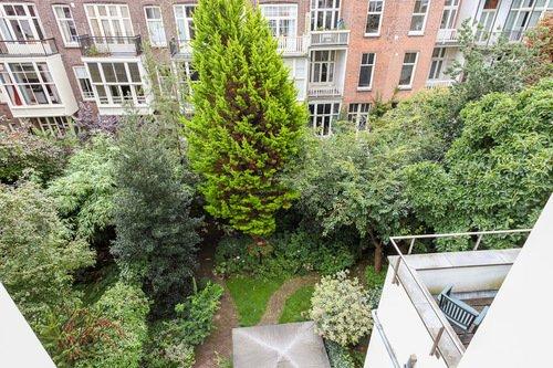 Zandbergen-Hotel-buiding-construction-white-window-mirror-door-balcony-wall-Backyard-Top-View-Green-Trees-view