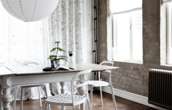 Casual-Nordic-Interior-In-Black-White-And-Grey-with-dining-table-bar-stool-chandelier-window-chair-window-curtain-hardwood-floor
