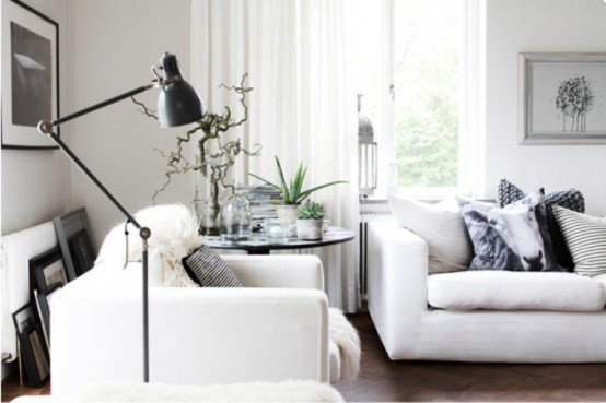 Casual-Nordic-Interior-In-Black-White-And-Grey-with-sofa-pillow-table-lamp-photo-frame-window-curtain-hardwood-floor-flower-decor