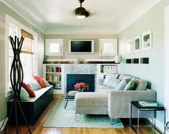 small living room fireplace porcelain tiles sectional sofa light blue walls daniel hennessy
