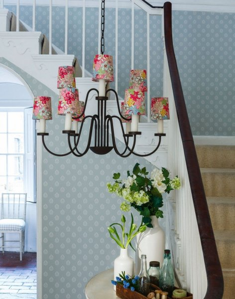 Pale-blue-country-hallway-with-oversized-chandelier