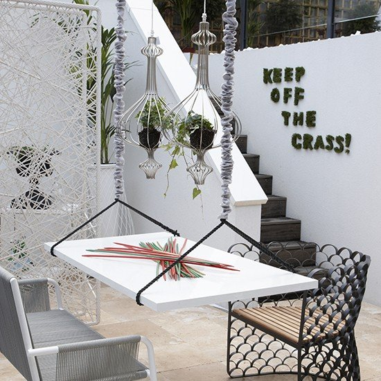 Small-garden-with-hanging-table-housetohome.co.uk