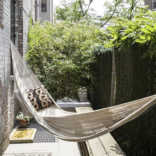 Small-outdoor-space-with-hammock-housetohome.co.uk