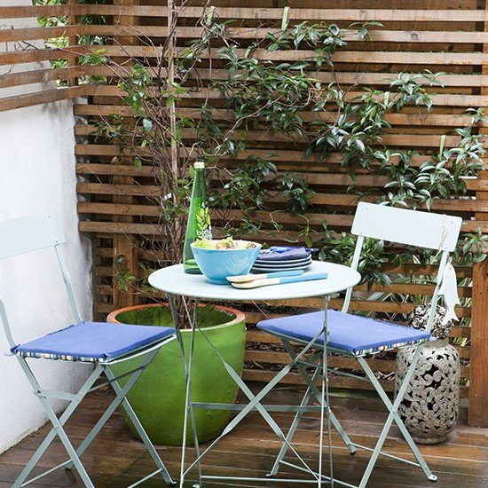 Small-patio-with-folding-furniture-housetohome.co.uk