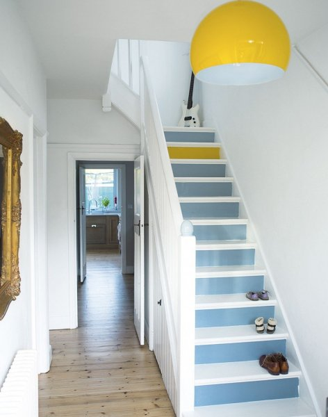 White-hallway-with-painted-stairs