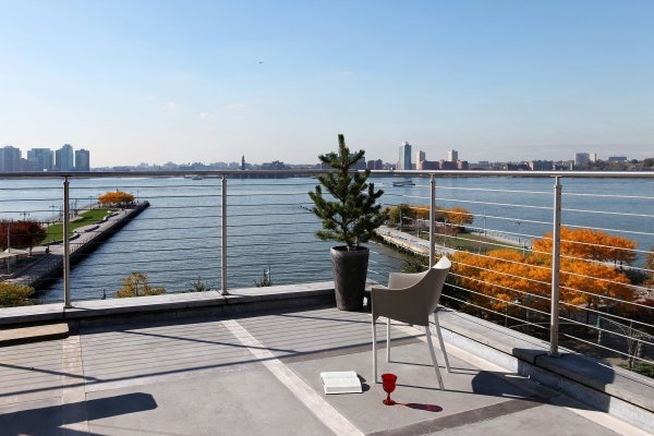 but-perhaps-the-most-gorgeous-part-of-the-home-is-its-rooftop-terrace-it-has-views-of-the-hudson-river-and-new-jersey-across-the-way