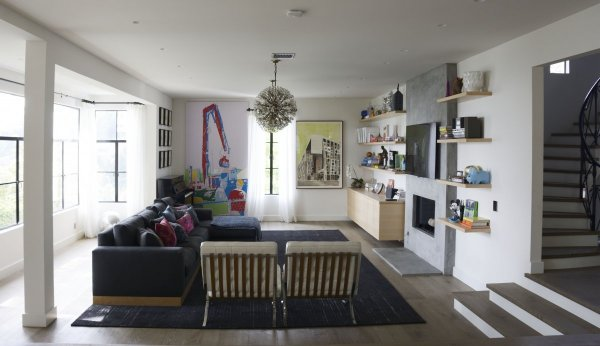 one-of-their-favorite-rooms-is-now-the-living-area-with-huge-open-windows-lots-of-light-and-a-tv-for-watching-netflix-bob-says-the-family-loves-movies-and-recently-watched-the-tower-records-documentary